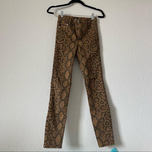 Snakeskin skinny jeans
